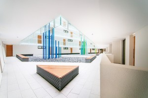modern communal lobby area with architectural geometric shapes
