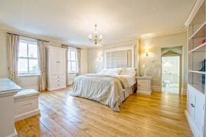 romantic bedroom with wooden floors