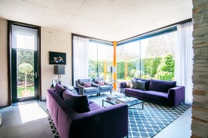 living room interior with floor to ceiling windows