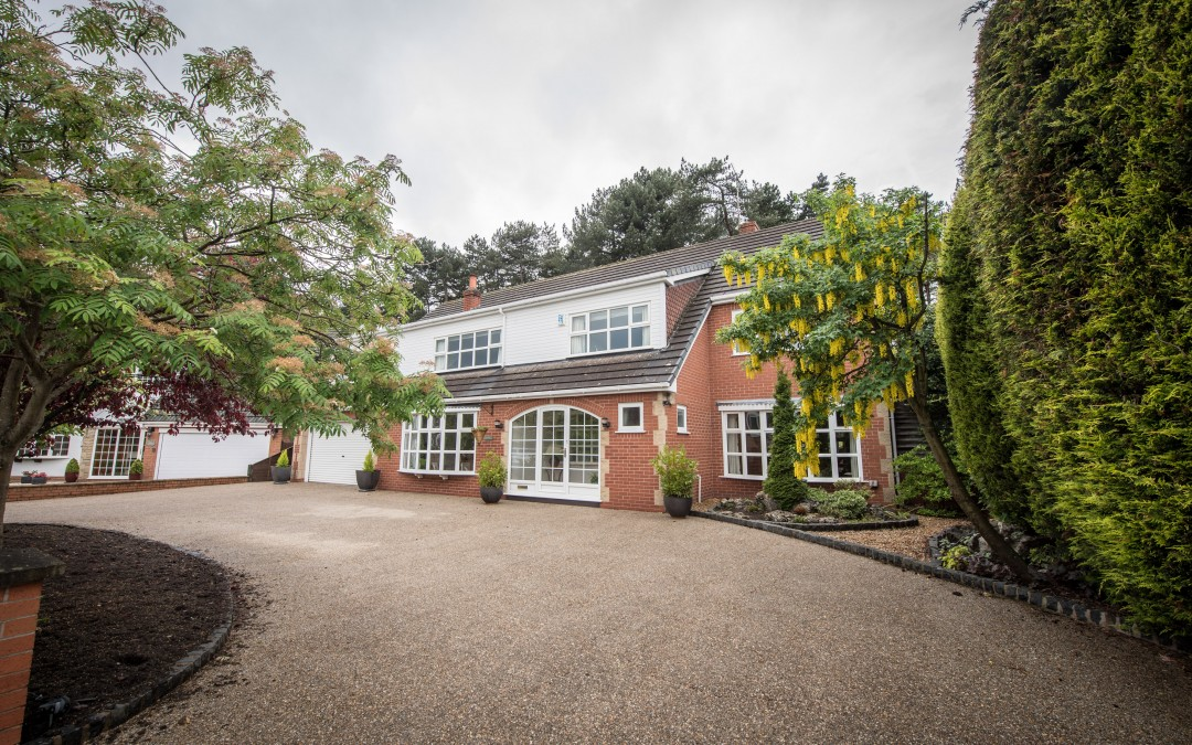 Exterior house image in Formby showing extensive drive